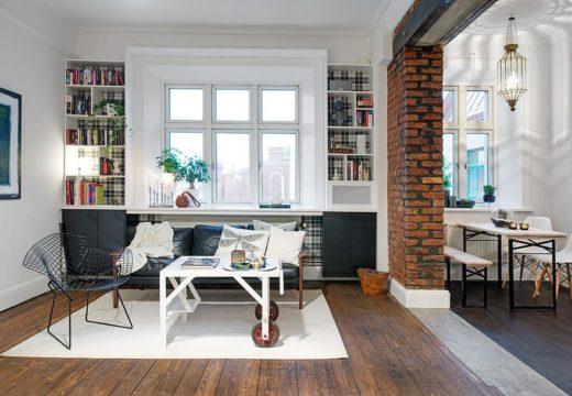 Decoración con contraste: Refacción de pequeño departamento con pisos de madera al natural